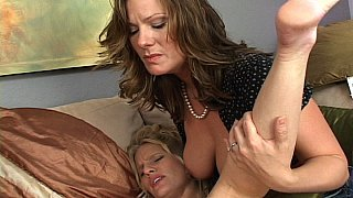 Two MILF hotties dildofucking their new girlfriend