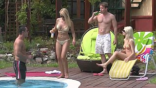 Hotvideosx Two tanned blonde Euro babes fucking by the pool