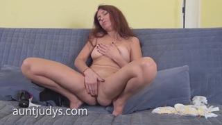 Mature Karolina Masturbates on a Gray Couch