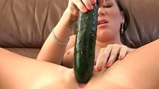 Excited big titted girl masturbates with cucumber
