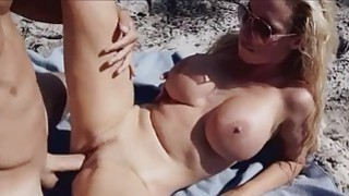 Big tittied chick in a motorboat