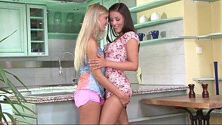 Cute lesbian teens in the kitchen