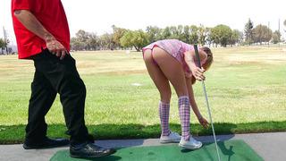 Karla Kush teasing her golf instructor with her short skirt