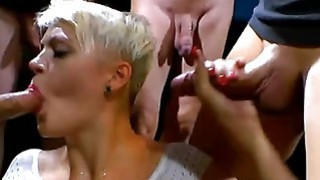 Hot European blonde babe gets pissed on by several hard cocks