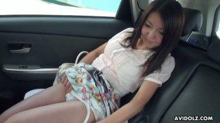 Yummy Japanese chick Mami Sugiyama is masturbating in the back seat