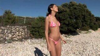 Bikini girl getting ready to tan