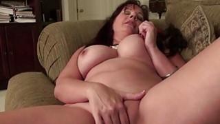 Huge titted mature brunette using a massive dildo