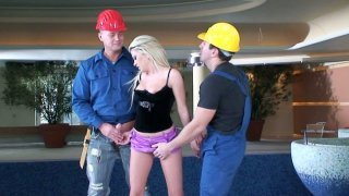 Bright cute blondie Alma Deluxe sucks two dicks of the workers