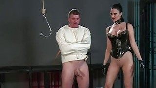Slave in straitjacket in femdom in dungeon
