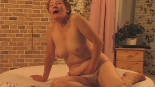 Red haired old wanker Nathalie polishes her twat with a sex toy