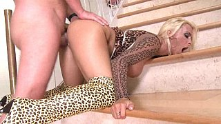 Big titted Holly Halston gets it on the stairs