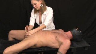 Sadistic mute destroys cock in bondage handjob